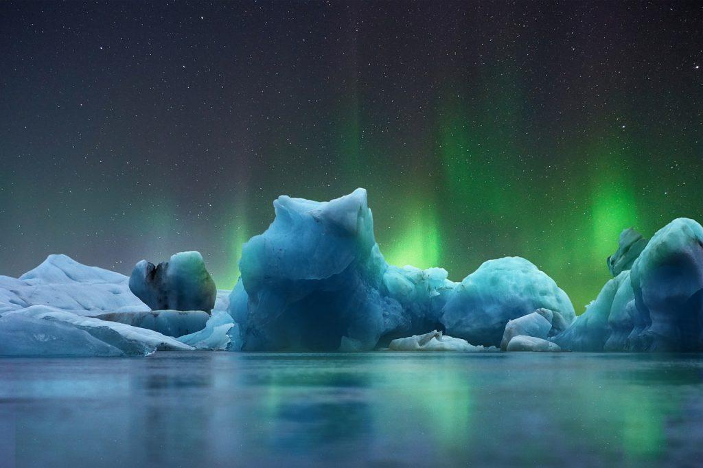 Iceberg with aurora borealis